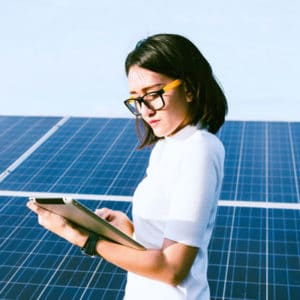 A Woman in front of solar panels
