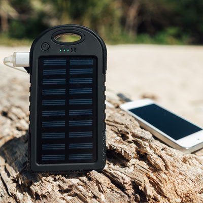 A solar charger charging a telephone