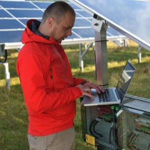 A Solar Technician working on a solar power system
