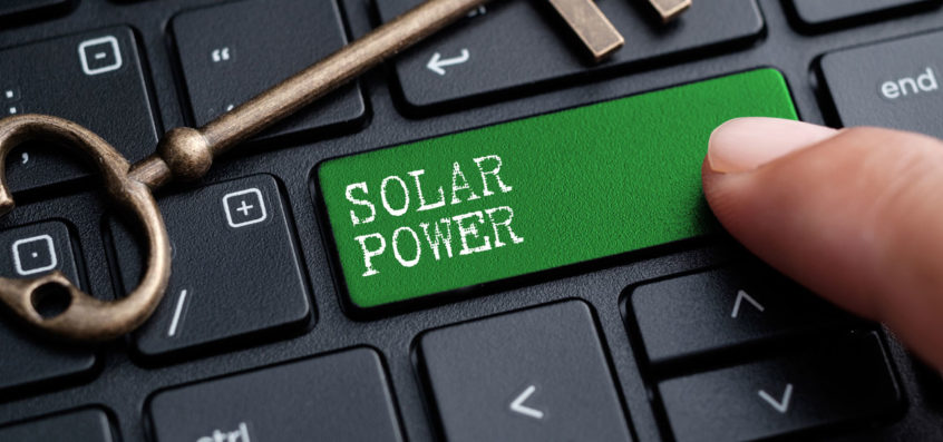 A laptop keypad with solar power on it as a symbol for solar power applications